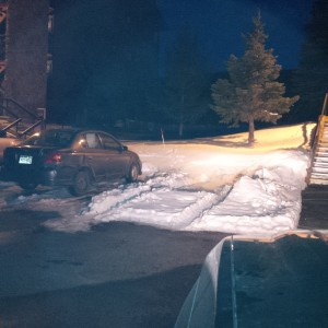 Although warm temperatures have prevailed, the snow remains where the vehicle had been stored next to the building stairs.